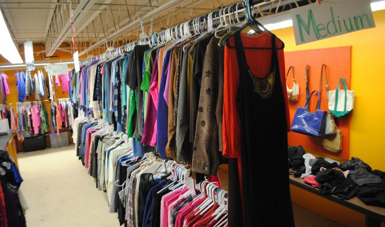 brightly colored clothing on racks in HOPE Boutique