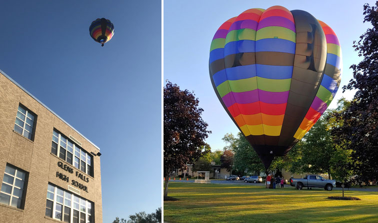 composite image of hot air balloon in front of glens falls high school