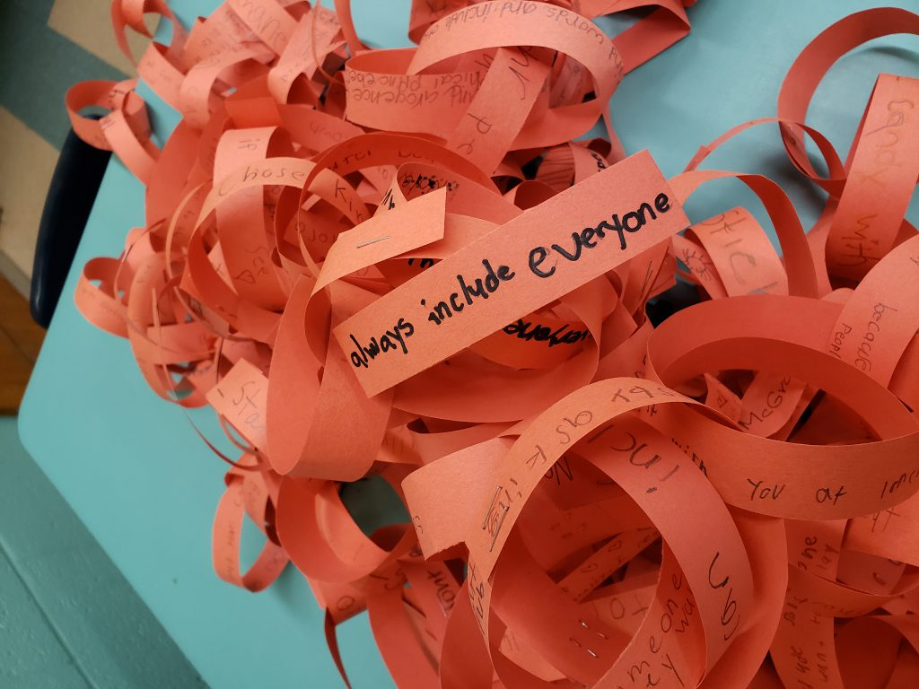 orange paper chains with anti-bullying messages on them